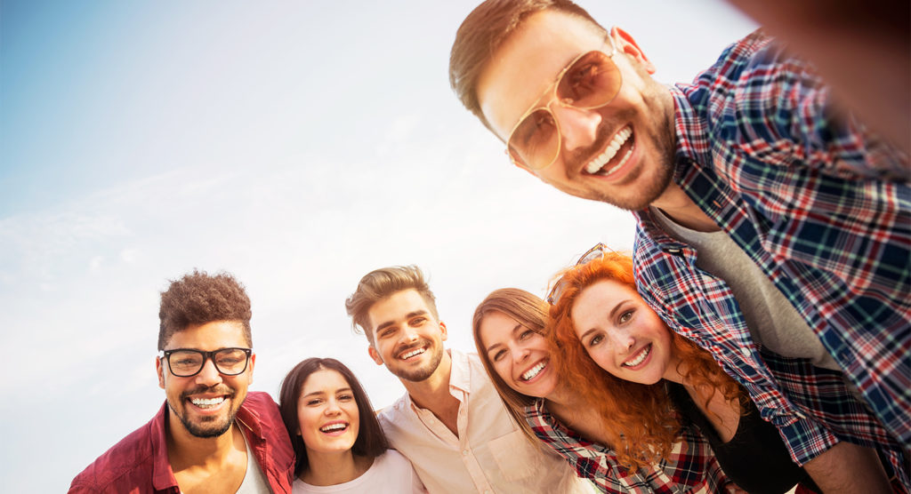 Zana Website Homepage header with happy young adults smiling with each other